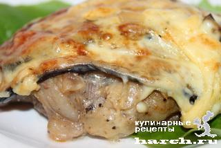 Свинина, запеченная с грибами под баклажанами